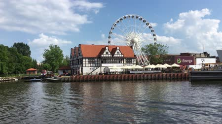 haven : Entertainment center with Ferris wheel at the river Motlawa in Gdansk - Poland.