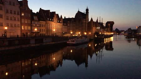 Cityscape of Gdansk at the river Motlawa at night - Poland.