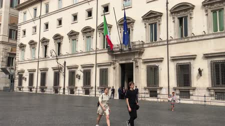People in front of the Palazzo Chigi at the Piazza Colonna in Rome. Residence of the Italian Prime Minister - Italy