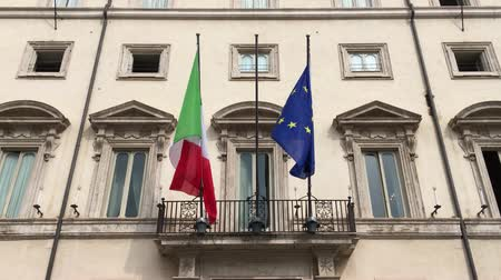 Flags at the Palazzo Chigi at the Piazza Colonna in Rome. Residence of the Italian Prime Minister - Italy.