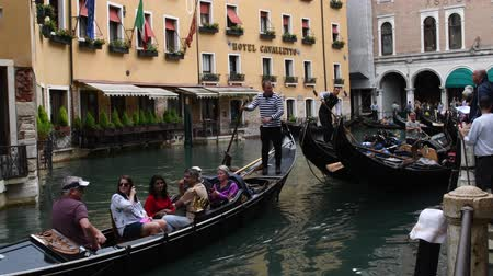 Gondola ride on a San Marco canal in Venice - Italy.