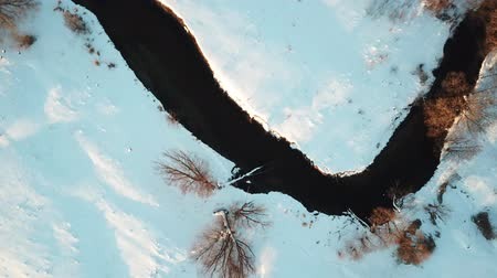 marchs financiers : Flying over small river. Aerial view landscape Stock Footage