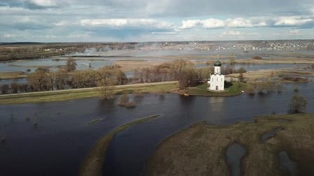Church of the Intercession on the Nerl. Vladimir region, Russia. Aerial view spring landscape Стоковые видеозаписи