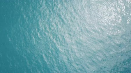 Turquoise sea water surface. View from above