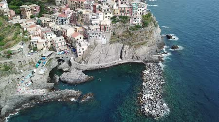 Manarola city on the rocky seashore. Cinca Terre. Italy