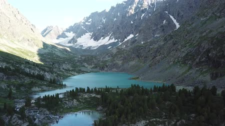 Kuiguk valley. Lake and waterfall in Altai mountains. Aerial view landscape