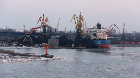 tersane : Freight Shipping Containers and Gas Oil Tanks at the Docks. In Import Export and Business Logistic. Cargo Ship Docked at at the Port. Cargo Cranes by Winter Evening in the Port Riga, Latvia. Stok Video
