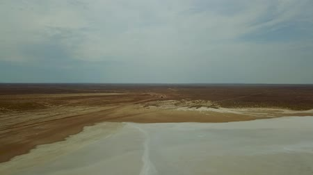 Road in the Steppes of Kazakhstan Muddy River. View on Very Long Road Till Horizon. Boundless Kazakh Steppes Dried Up Lake. Areal Dron shoot.