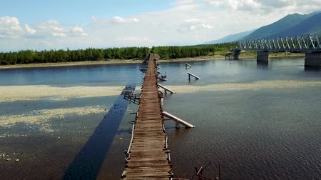 Kuandinsky Bridge over the Vitim River, located on the border of Zabaikalsky region and the Republic of Buryatia, is definitely one of the most dangerous road bridges in the world.