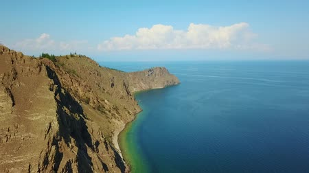 haziran : Olkhon Island on Baikal Lake Cape Burhan. Rocky and Sandy Beach Bay in Huzhir Village.