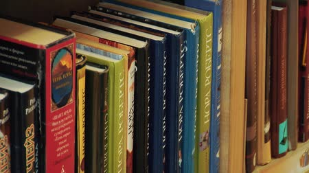 kötött : A Rack of Books Arranged in a Local Library. Many Library Books on Shelves in Stacks. Reading And Science, School And University, School Library, Bookstore, Books On Bookshelves, Stack Of Old Books.