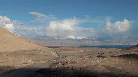 pamirs : Karakul Lake Tajikistan. M41 Pamir Highway, Khorog, Tajikistan. Karakul Lake Is a Large Lake High in the Pamir Mountains (Altitude 3914 M). Located in the Tajik National Park in the Pamir Mountains Stock Footage