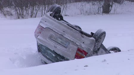 brake : Crashed Car Upside Down on the Roof  After an Accident on Winter Road With Snow. Accident With a  Car in Winter on Road, Slippery Icy Road, Danger Driving