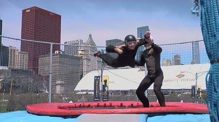 арена : Chicago - April 30, 2015 NFL Draft. Skydiving Simulator Wind Tunnel at the Draft Town.The Attraction Is Called the Sweetness Simulator NFL Fans Fly Against the Backdrop of the Chicago Skyline.
