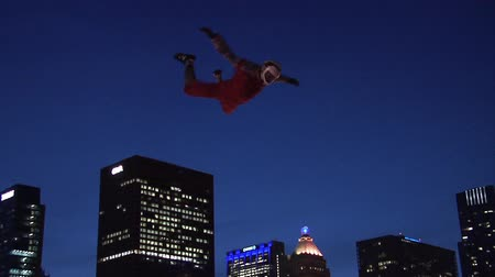 leaping : Chicago - April 30, 2015 NFL Draft. Skydiving Simulator Wind Tunnel at the Draft Town.The Attraction Is Called the Sweetness Simulator NFL Fans Fly Against the Backdrop of the Chicago Skyline.