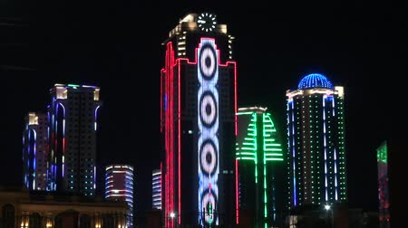 citynight : GROZNY, RUSSIA - JUNY 24, 2018: Skyscrapers in  Neon Light Grozny Chechnya at the Night. Buildings in the District of Grozny City Chechnya Heart