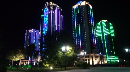 cityskyline : GROZNY, RUSSIA - JUNY 24, 2018: Skyscrapers in  Neon Light Grozny Chechnya at the Night. Buildings in the District of Grozny City Chechnya Heart