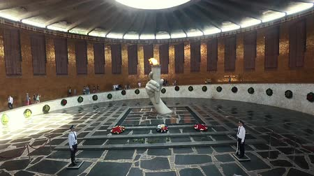 socialism : Volgograd, Russia - JUNE 24,2018. eternal flame in a Hall of Military Glory on Mamayev Kurgan Visitors and Tourists of the Memorial Complex on the Anniversary of Victory in Great World War II.