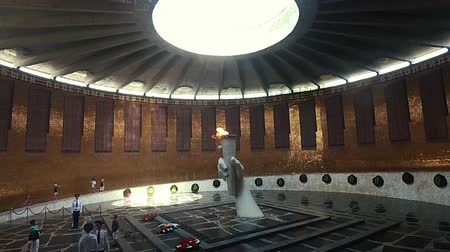 sosyalizm : Volgograd, Russia - JUNE 24,2018. eternal flame in a Hall of Military Glory on Mamayev Kurgan Visitors and Tourists of the Memorial Complex on the Anniversary of Victory in Great World War II.