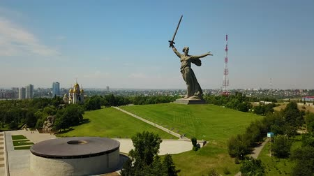 mamaev : Aerial Shot Of the Motherland Statue in Mamaev Kurgan. Stalingrad  Volgograd. Visitors and Tourists of the Memorial Complex on the Anniversary of Victory in Great World War II.