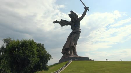 mamaev : Motherland Statue in Mamaev Kurgan. Stalingrad  Volgograd. Visitors and Tourists of the Memorial Complex on the Anniversary of Victory in Great World War II. Stock Footage