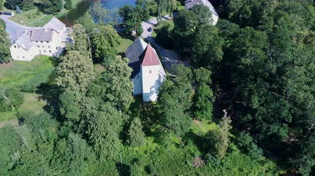 Aerial Dron Shot of the Cirava Lutheran Church Aizpute Latvia, Sunny Summer Day. Flaying Above the Church and Manor Castle.from the Outside It Was Similar to Other Churches of Kurzeme