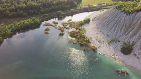 kalker : Aerial landscape Sand Hills of Quarry With a Pond and Abandoned Prison in Rummu Estonia Europe. Flooded Houses of Former Prison. Mountain in the Abandoned Mines Sunken Ruins of Soviet Time Prison Stok Video