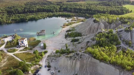 Aerial landscape Sand Hills of Quarry With a Pond and Abandoned Prison in Rummu Estonia Europe. Flooded Houses of Former Prison. Mountain in the Abandoned Mines Sunken Ruins of Soviet Time Prison Dostupné videozáznamy