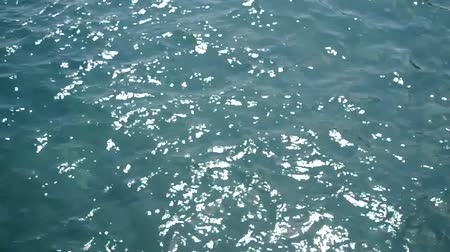 river ocean : transparent sea water in shallow with glare from sun Stock Footage