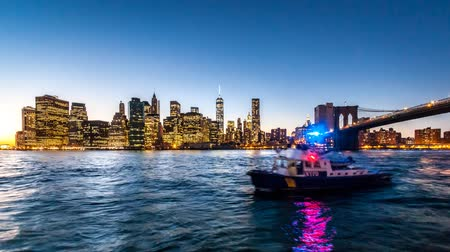 kentsel : Lower Manhattan timelapse going through sunset, twilight and night, while boats sail the East River
