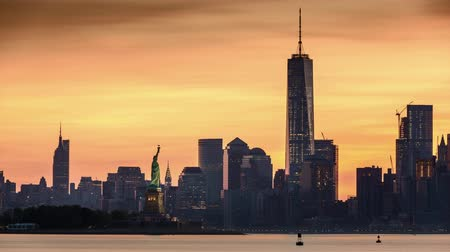 freedom tower : Timelapse with Lower Manhattan Freedom Tower and The Statue of Liberty at sunrise Stock Footage