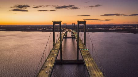 palmo : Aerial timelapse of Delaware Memorial Bridge at dusk. The Delaware Memorial Bridge is a set of twin suspension bridges crossing the Delaware River between the states of Delaware and New Jersey