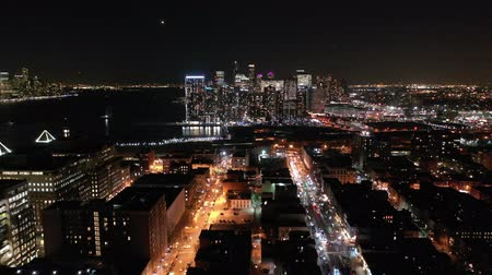 arka görünüm : Aerial footage by night, above Hoboken, New Jersey, between Hudson street and Washington street, with pull back from Jersey City skyline camera motion
