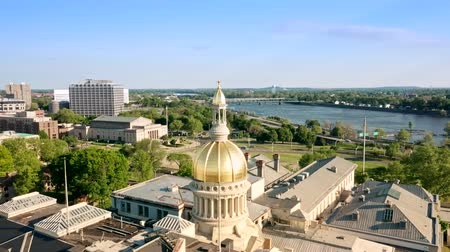 governor : Drone footage of Trenton downtown on a sunny afternoon with camera moving around the state Capitol. Trenton is the capital city of the U.S. state of New Jersey and the county seat of Mercer County Stock Footage