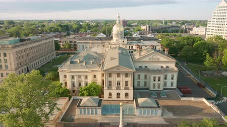 new jersey : Drone footage of capitol building in Trenton on a sunny afternoon with slow uplifting camera movement. Trenton is the capital city of the U.S. state of New Jersey and the county seat of Mercer County