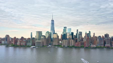 Aerial drone footage of downtown New York skyline. The camera moves towards the Lower Manhatttan skyline 무비클립