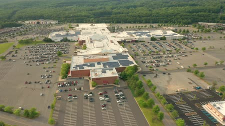 Aerial drone shot above a large american mall with forward camera motion 무비클립