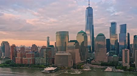 Slow drone rotation around Lower Manhattan skyline at sunset 무비클립