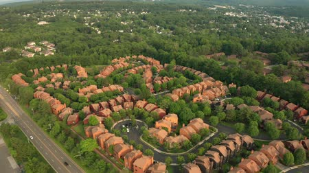 Late afternoon, forward moving drone footage of a suburban community in New Jersey.