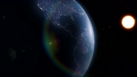 on nature : Earth as seen from space. 3D animated. City lights are visible on the dark side of the earth. Stock Footage