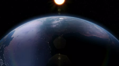 raios de sol : Seamless loop of earth as seen from space. 3D animated. City lights are visible on the dark side of the earth.