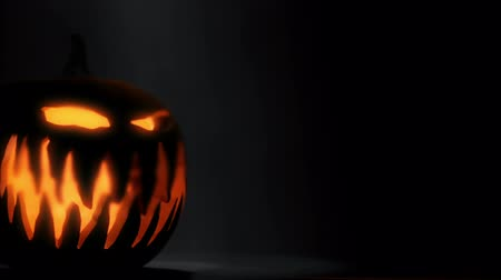 október : Halloween pumpkin head rolling.  3D animation of a Jack O Lantern thrown and rolling towards the camera.