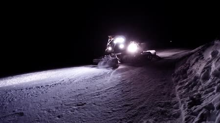 snowcat : snow cat working in the night