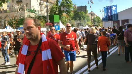 fan zone : Kiev, Ukraine, May 2018: - City residents and football fans are walking in the fan zone on the eve of the final match of the UEFA Champions League between Liverpool and Real Madrid.