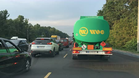 truck stop : Kiev, Ukraine, August 2018: - Rows of cars on the road stop on the highway by traffic jam or move very slowly. Shots through the windshield of the car.