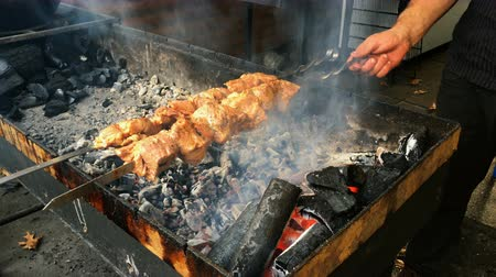 sığır : Grilling time. Beef or pork steaks on the grill with flames over the coals on barbecue. Delicious food. Close-up.