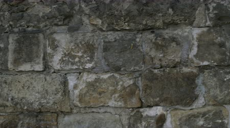 wall building feature : Detail of natural gray stone wall texture. Old vintage. Buildings background. Close-up. Stock Footage