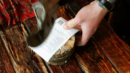 hatchet : Original method of calculation in the restaurant. Check for lunch is nailed to the stump with ax.