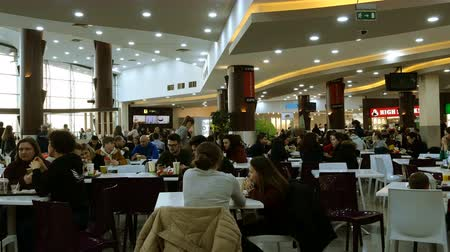 cena urbana : Kiev, Ukraine, February 2019: - Food court interior in supermarket or mall. Restaurants at the supermarket Sky Mall. Stock Footage