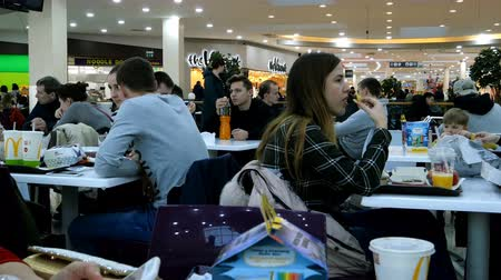 candida : Kiev, Ukraine, February 2019: - Food court interior in supermarket or mall. Restaurants at the supermarket Sky Mall. Stock Footage
